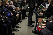 A young couple hold carnations in the Kiev's subway. Carnations are laid in Maidan square in memory of the activists who were killed by police snipers during clashes on February 20. 26 February 2014.