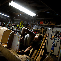 LIVE OAK, FL -- September 30, 2010 -- Boatwright Aaron Wells of Cypress Kayaks LLC, sets up forms as he works on a hand-made wooden canoe in his shop in Live Oak, Fla., on Thursday, September 30, 2010.  (Chip Litherland for Bay Magazine)