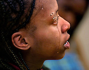 Tanieshia Streeter cries as she retells the trials of her younger life and having to care for her mother who died of sickle cell anemia complications.