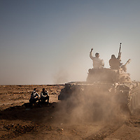 Rebels drive a tank to a new posistion near Benghazi on March 3, 2011.
