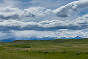 Rain storm over the Rocky Mountains along US Route 89 in the Great Plains of northern Montana