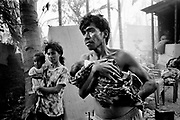 East Timorese return to the burnt out remains of their homes only to find rogue elements with the departing Indonesian Military burning nearby buildings. September 1999