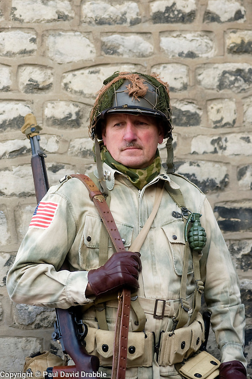 """Pickering 1940s war weekend. A reenactor portrays a member of a US Airborne unit complete with personal weapon and """"Pineapple"""" fragmentation grenade, 2009 Image Copyright Paul David Drabble"""