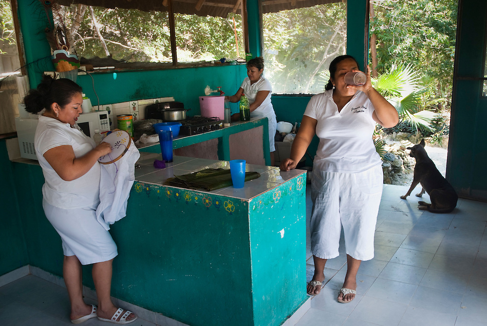 Lunch break for the mayan women at the Jungle Spa...The Jungle Spa in Puerto Morelos, Mexico, just 20 minutes from Cancun is managed by Sandra Dayton who is also the co-founder of the non-profit organization Lu'um K'aa Nab that helps mayan women make a living for them selves by selling handicraft and giving mayan massage at the Jungle Spa.