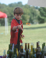 "Maxwell Mobley plays ring toss during St. Peter's Episcopal Church's ""Fun in the Country"" in Oxford, Miss. on Monday, September 6, 2010."