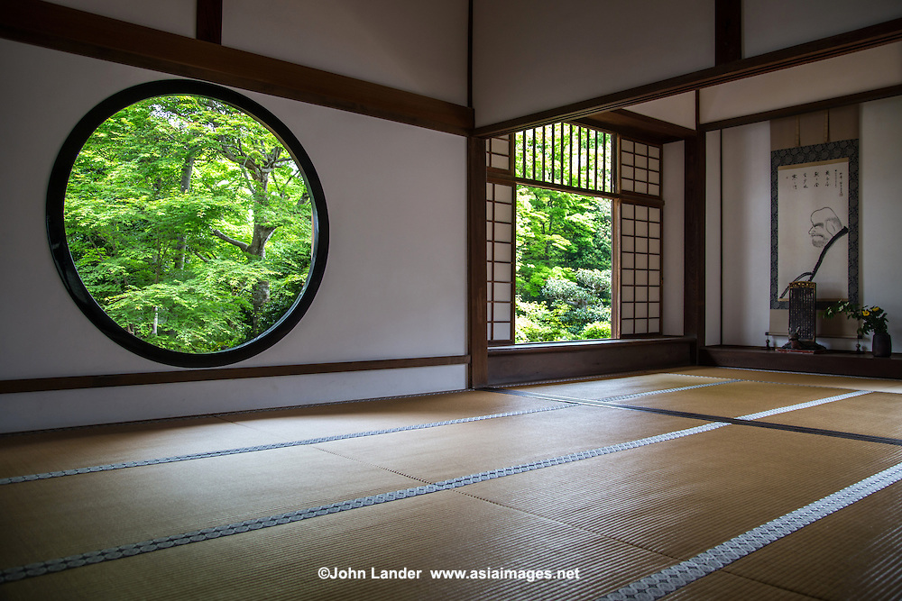 """Genko-an is famous for its two large windows.  """"The Window of Enlightenment"""" is round, showing the harmony of the universe.  The squared window is called """"The Window of Confusion"""" symbolising humans' lives of suffering.  Both windows overlook the same garden, though the effect of looking through each window is quite different.  The garden's plants and stones are arranged to create an elegant world of wabi and sabi.  Genko-an Temple was originally built as a hermitage for the head priest of Daitoku-ji Temple, but was turned into a Zen temple."""