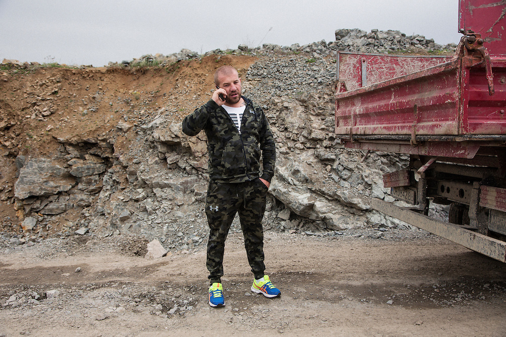 Dinko Valev at a quarry in Yambol, Bulgaria. He was gathering stone to build a wall around his new junkyard property.<br /> <br /> Matt Lutton / Boreal Collective for VICE