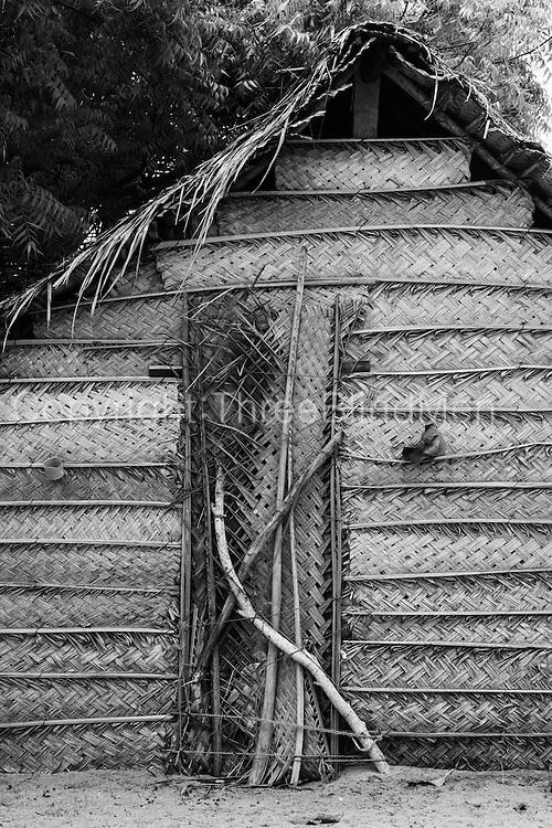 Cadjan (thatch) homes on the sand bar North of Kalpitiya.