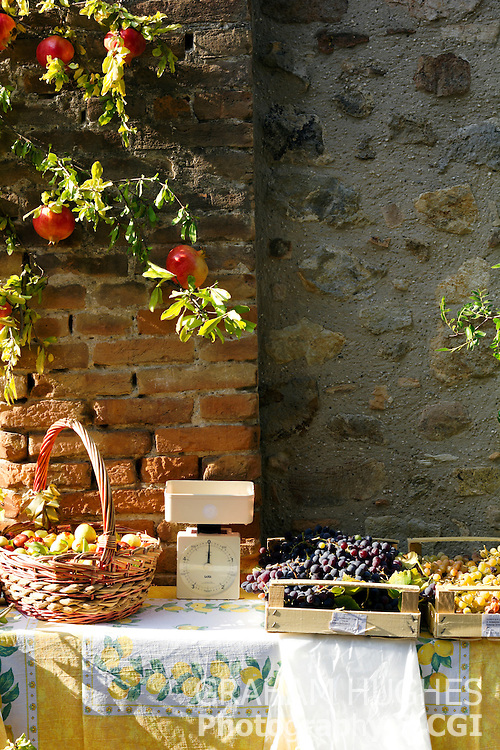 Fruit stall in alleyway in Arqua Petrarca, Italy.