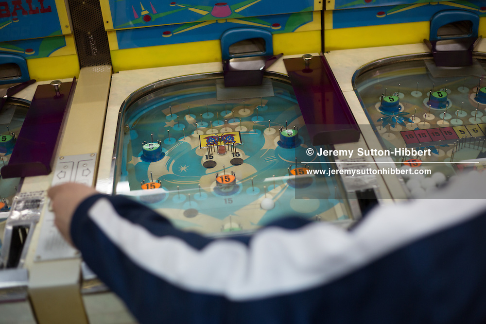 Playing the old pinball machine called SmartBall, in Shinsekai district, in Osaka, Kansai region, Japan, Wednesday 13th June 2012.