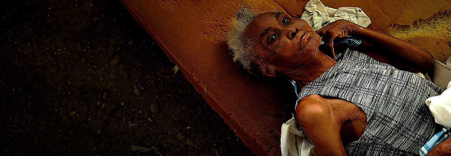 Pulled from rubble, Yvonne, an 80 year old injured woman lies on a pad outside in a make shift hospital at the General Hospital in Port au Prince, Haiti on January 18, 2010. Due to a large number of injured the hospital has extended out and into the court yard after a devastating  earthquake hit the region on January 12, 2010. (U.S. Air Force photo by Master Sgt. Jeremy Lock) (Released) | Jeremy Lock Photography