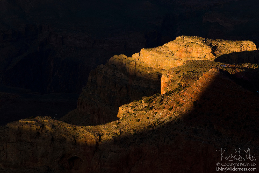 The late afternoon sun highlights the top of Horseshoe Mesa, located in Grand Canyon National Park, Arizona.