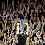"SHOT 2/14/13 9:05:05 PM - The Colorado student cheer section performs the ""rollercoaster"" cheer during their regular season Pac-12 basketball game at the Coors Event Center on the Colorado campus in Boulder, Co. Colorado won the game 71-58. The student cheering section is nicknamed the C-Unit. (Photo by Marc Piscotty / © 2013)"