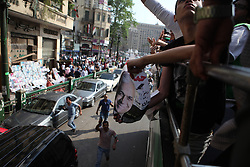 Sabahi's bus drives through Tahrir Square, the epicentre of the uprising against former President Hosni Mubarak.