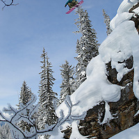 A snowboarder soars over powder pillows at the Revelstoke Mountain Resort in BC, Canada.