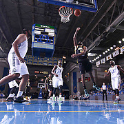 Delaware 87ers Guard DJ Seeley (18) drives towards the basket as Reno Bighorns Center Sim Bhullar (44) (LEFT) attempts to defends in the first half of a NBA D-league regular season basketball game between the Delaware 87ers and the Reno Bighorns (Sacramento Kings), Tuesday, Feb. 10, 2015 at The Bob Carpenter Sports Convocation Center in Newark, DEL