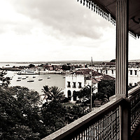 Stone Town, Zanzibar 05 November  2010<br /> View of the port from Beit al-ajaib or &quot;House of Wonders&quot;, Zanzibar's best-known historic building. Built as a ceremonial and administrative palace by Sultan Barghash in 1883. Now a National Museum. Stone Town or Mji Mkongwe, in Swahili meaning &quot;ancient town&quot;, is the old part of Zanzibar City, the capital of the island of Unguja, informally known as Zanzibar, part of Tanzania. The town was the centre of trade on the East African coast between Asia and Africa before the colonization of the mainland in the late 19th century after which the focus moved to Mombasa and Dar es Salaam. From 1840 to 1856, Said bin Sultan had the capital of the Omani Empire in Stone Town. The main export was spices and particularly cloves. For many years Stone Town was a major centre for the slave trade; slaves were obtained from mainland Africa and traded with the Middle East. The town also became a base for many European explorers, particularly the Portuguese, and colonizers from the late 19th century. David Livingstone used Stone Town as his base for preparing for his final expedition in 1866. A house, now bearing his name, was lent by Sultan Seyyid Said. Immigrant communities from Oman, Persia and India lived here. <br /> Photo: Ezequiel Scagnetti