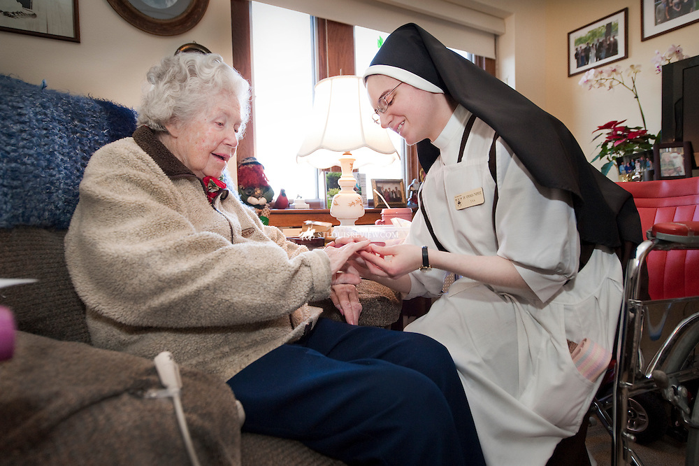 Sr. Veronica Therese, a Carmelite Sister of the Divine Heart of Jesus,made a care visit to the apartment of St. Agnes Resident, Catherine Smith.  The two chatted about family and  Smith's five children while Sister Veronica Theresa helped with nail care.