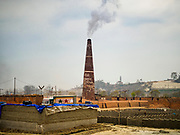 09 MARCH 2017 - BAGMATI, NEPAL: A brick factory in Bagmati, near Bhaktapur. There are almost 50 brick factories in the valley near Bagmati. The brick makers are very busy making bricks for the reconstruction of Kathmandu, Bhaktapur and other cities in the Kathmandu valley that were badly damaged by the 2015 Nepal Earthquake. The brick factories have been in the Bagmati area for centuries because the local clay is a popular raw material for the bricks. Most of the workers in the brick factories are migrant workers from southern Nepal.           PHOTO BY JACK KURTZ