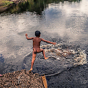 A jump in the river at the Tucano community
