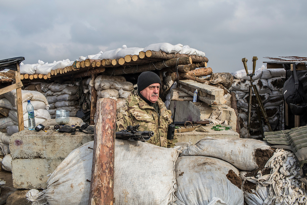MARIINKA, UKRAINE - FEBRUARY 21, 2016: Lt. Col. Mikhailo M. Prokopiv, commander of Ukrainian Army forces in Mariinka, at a front-line position in Mariinka, Ukraine. The Donetsk suburb has been the scene of some of the heaviest fighting recently between Ukrainian forces and pro-Russian rebels. CREDIT: Brendan Hoffman for The New York Times