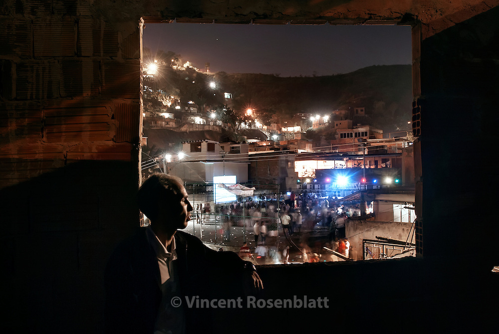DJ Pernalonga is the organizer of one of the most famous bailes funk in Rio de Janeiro's North area, in the favela Arvore Seca. Here, he is supervising the baile of Favela Boca do Mato, in the borough of Lins, North area of Rio..