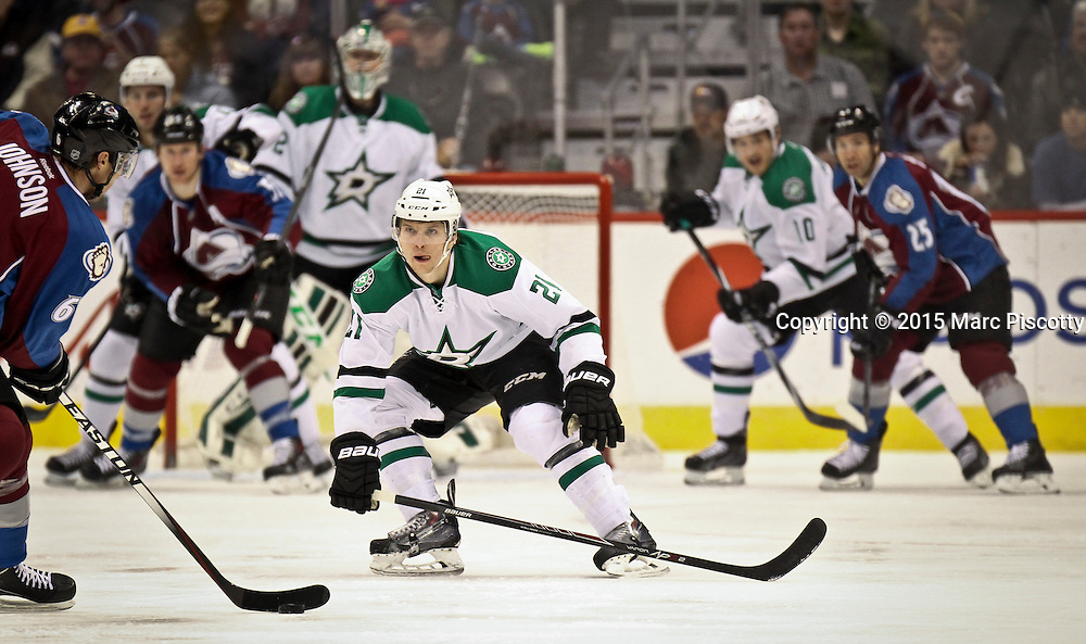SHOT 1/10/15 1:13:08 PM - Rhe Dallas Stars' Antoine Roussel #21 attempts to black the shot of the Colorado Avalanche's Erik Johnson #6 during their regular season game at the Pepsi Center in Denver, Co. Colorado won the game 4-3.  (Photo by Marc Piscotty / © 2015)
