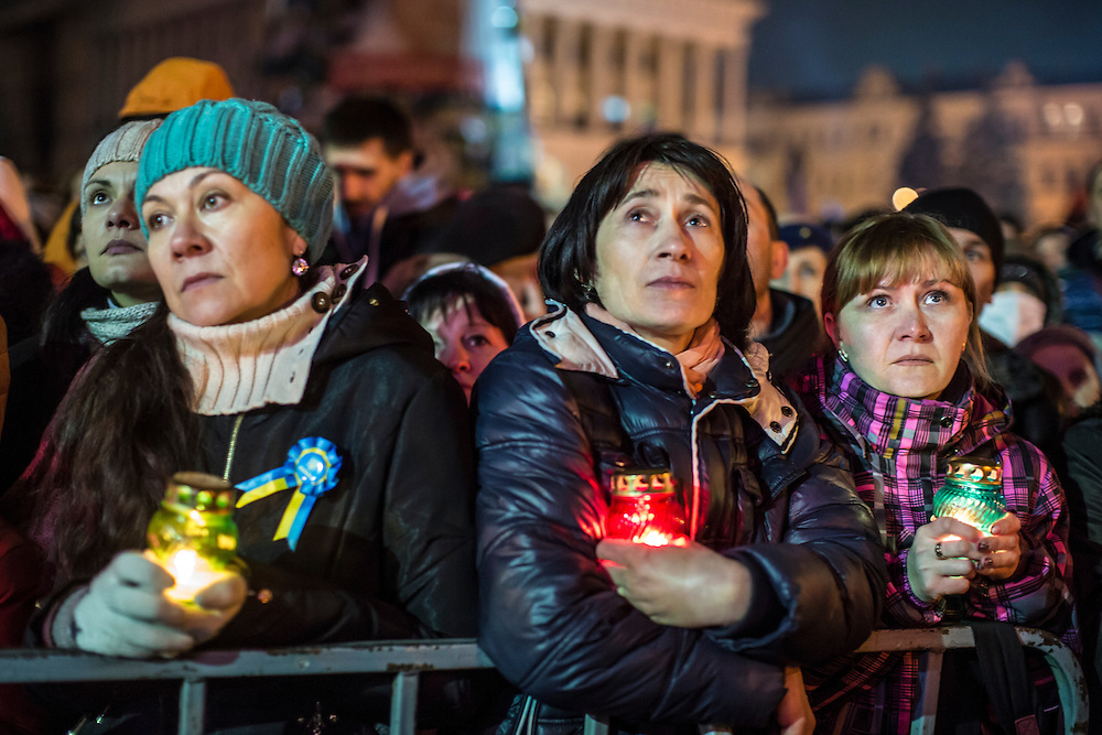 KIEV, UKRAINE - FEBRUARY 22: Women hold candles during a vigil for anti-government protesters killed in clashes with police earlier in the week as they wait for former Prime Minister Yulia Tymoshenko to address the crowd on Independence Square on February 22, 2014 in Kiev, Ukraine. The leader of the 2004 Orange Revolution against current embattled President Viktor Yanukovych traveled to Kiev to address the crowd immediately after being released from prison on what many claim were politically motivated charges. (Photo by Brendan Hoffman/Getty Images) *** Local Caption ***