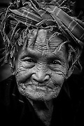 Myanmar. Older woman at Aungban weekly market wearing a head scarf.<br /> Shan State.
