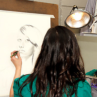 WSU junior Ashlee Malloris creates a self-portrait during the 13th Annual ArtsGala at Wright State University's Creative Arts Center, Saturday, March 31, 2012.
