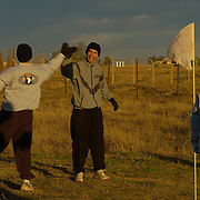 Dec 12th 2003..Quyarra, Mosul, Iraq.....Major Kirk Whitson (center) gives Lt-Col Jeff Kelley a 'high five' at the end of their Friday morning round of golf. The six hole course was built by Lt Jesse White of the 101st Airbourne 'Task Masters' at a base 50 kms south of Mosul in Northern Iraq. By location this course is perhaps the most hostile in the world and is reckoned to be the first and only in Iraq.