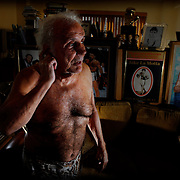 'The Raging Bull' Jake La Motta amongst  the memorabilia from his boxing career in his New York Apartment.