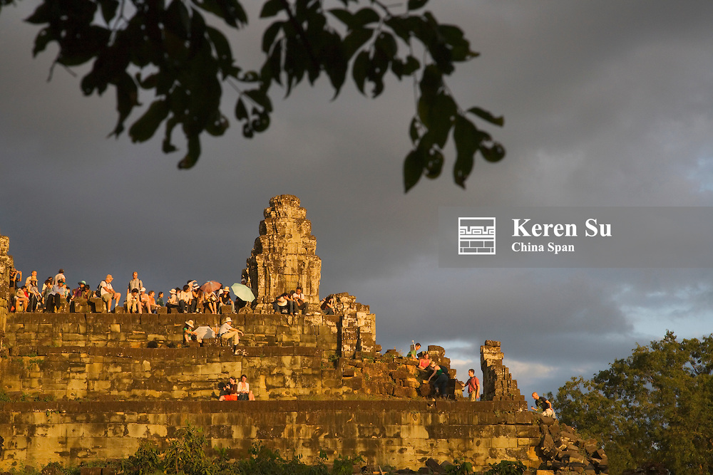 Ruins on Bakheng Hill at sunset, UNESCO World Heritage site.