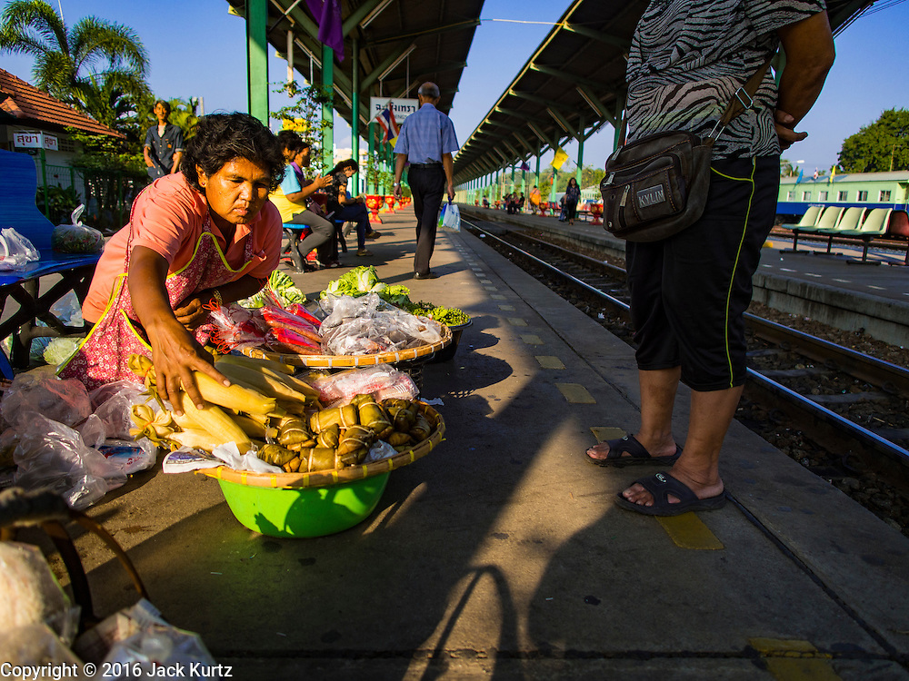 14 JANUARY 2016 - CHACHOENGSAO, CHACHOENGSAO, THAILAND: A woman sells fresh produce on the platform in Chachoengsao Train Station.         PHOTO BY JACK KURTZ