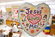 Pre-K teacher Karen Kellar helps her students paint at Holy Cross Lutheran Church and School in Collinsville, Ill., on Friday, Feb. 21, 2014. LCMS Communications/Erik M. Lunsford