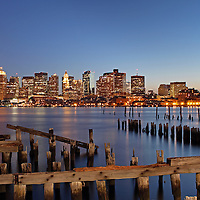 Most beautiful Boston skyline night photography from New England and Boston based fine art photographer Juergen Roth showing landmarks such as Boston Downtown, Custom House of Boston, New England Aquarium, Boston Harbor, John Hancock building and Prudential Center captured on an early April spring night at twilight. <br />
