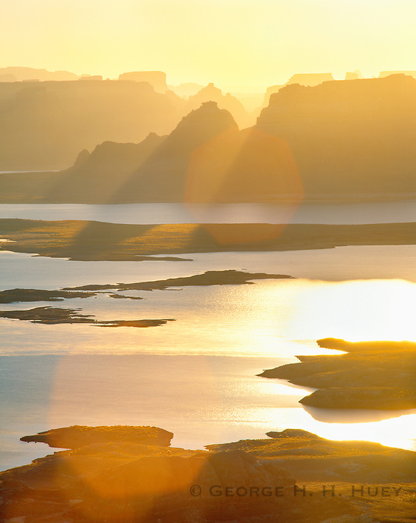 0306-1008 ~ Copyright:  George H. H. Huey ~ Sunrise over Padre Bay, Lake Powell.  Glen Canyon National Recreation Area.  Utah/Arizona. [Looking in to Arizona from Utah]