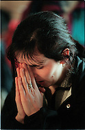 MEDJUGORJE, BOSNIA-HERCEGOVINA: A young woman prays inside St. James Parish Church in Medjugorje during a weekday Mass. In 1981, six children of the town claimed to have been visited by the Virgin Mary. Since then, millions of pilgrims have come to the town in search of Miriam of Nazareth.  (Photo by Robert Falcetti). .