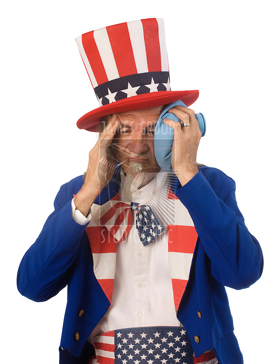 Uncle Sam feeling sick with an oral thermometer and an ice bag shot on a white background