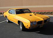 1970 Orbit Orange Pontiac GTO Judge in a Target Parking lot, classic Muscle Car.