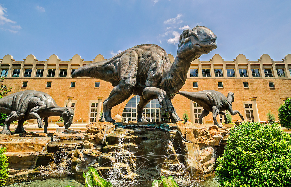 A family of bronze dinosaurs — lophorhothon atopus — frolic in the Dinosaur Plaza in front of of the Fernbank Museum of Natural History, in Atlanta, Georgia, May 23, 2014. In August 2009, Fernbank patrons voted to name the dinosaurs, from left, Haddie, Georgia, and Ferny. (Photo by Carmen K. Sisson/Cloudybright)