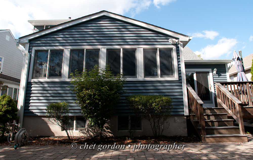 Rear view of Craig Furer's Cranford, NJ home on Sunday, October 23, 2016. Furer and his wife Jen hired Magnolia Home Remodeling Group to complete a full exterior makeover. The company replaced the siding with shake and clapboard, added various architectural accents, replaced the roof, modified the roofline, built a front portico and replaced two windows. Craig spent a lot of time researching this project before it began and is thrilled with the overall result.  © Chet Gordon for Angie's List