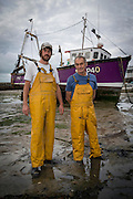 Harry &amp; Fred Mardle<br /> <br /> Samallen - P40<br /> <br /> 5th &amp; 4th Generation Fishermen<br /> <br /> Main Activities: Potting, Netting, Trawling &amp; Channel Swims<br /> Folkestone was founded on its fishing industry which dates back to pre-Roman times.  During its heyday there were over 100 boats operating out of the busy harbour and employing over 1000 people in the town.  However today, there are only 8 working boats left, employing just over 20 people. The boats are owned and managed by Folkestone families who have a strong fishing heritage. Photographer Andrew Aitchison, has been working with Folkestone Trawlers to capture portraits of the active fishermen in the summer of 2016.