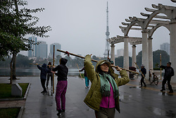 Locals practice tai chi early in the morning in Lenin Park, Hanoi, Vietnam, Southeast Asia