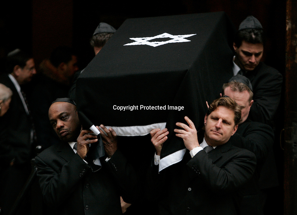 Pallbearers carry the casket of Andrea Bronfman after memorial services at the B'nai Jeshurun synagogue in New York January 25, 2006. Bronfman, wife of Charles Bronfman, heir to the Canadian Seagram's liquor empire, was struck and killed by a car on Monday. Photo by Keith Bedford