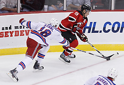 Oct 5, 2009; Newark, NJ, USA; New Jersey Devils left wing Zach Parise (9) skates with the puck past New York Rangers defenseman Marc Staal (18) during the third period at the Prudential Center. The Rangers defeated the Devils 3-2.