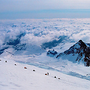 Climber rest on their way up Mt Rainier in Washington. Trip taken May 1999.<br />