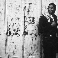 A student at Mumford High School in Detroit stands against lockers in a school hallway in 1981.