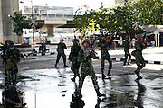 Military forces loyal to the government retreat to safety after violent clashes with  the 'Red Shirts'...Violence between the 'Red Shirts' of the UDD and police / government military forces on the city streets of Bangkok. The UDD (United Front for Democracy Against Dictatorship) says Prime Minister Abhisit Vejjajiva came to power illegitimately and is a puppet of the military. The movement is made up of supporters of former Prime Minister Thaksin Shinawatra who was ousted in a coup in September 2006. The UDD wants Mr Abhisit to resign and call fresh elections.