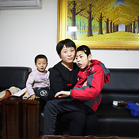 Beijing, March 11 : Tian Peng, 15, is taken care of by his mother Cui Xinying while his little brother Tian Ye, 3, sits next to them on the sofa.<br /> As a baby Tian Peng fell ill with brain   hemorrhage supposedly due to a lack of vitamin K. When Tian Peng was a kid, friends advised the parents to simply abandon him as there's neither enough help nor support in China apart from a small NGO. Tian is unable to speak, think, walk and needs help for everything.<br /> Chinese attitudes towards people with disabilities have improved in recent years, but the support of society and opportunities in education and employment are scarce.